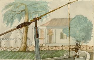 INDIAN MAN DRAINING WATER, WITH BUNGALOW by White, George